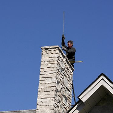 Man on top of chimney